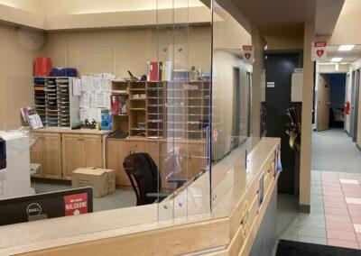 Reception desk sneeze guard barrier custom design and installation